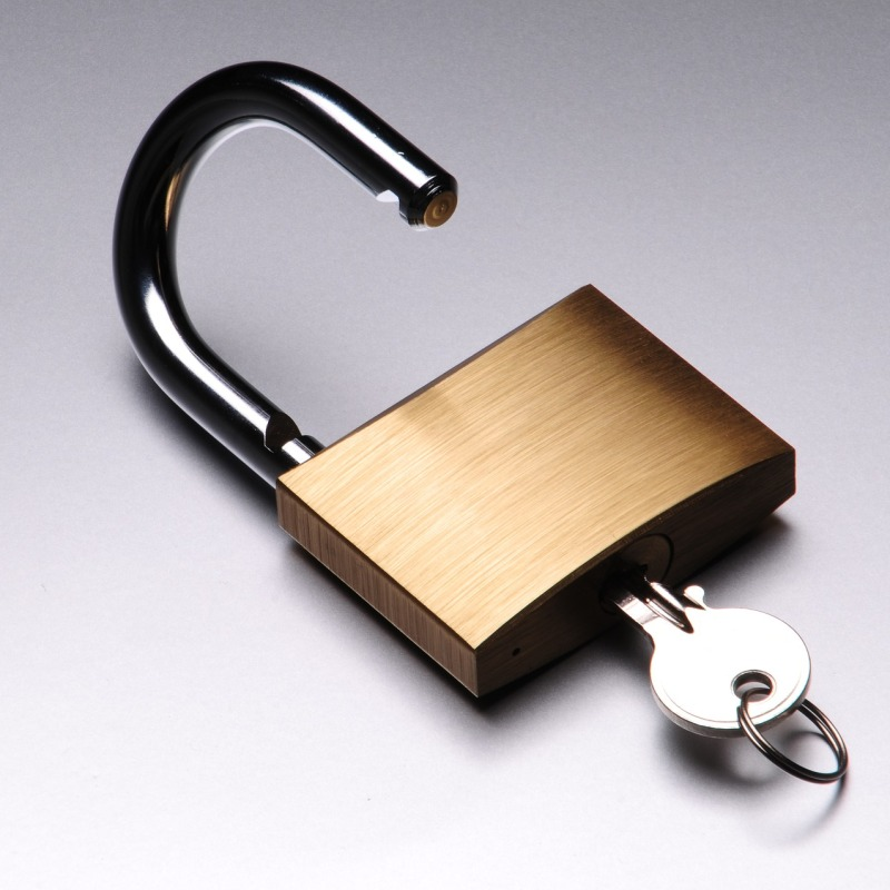 Open padlock with a key inserted